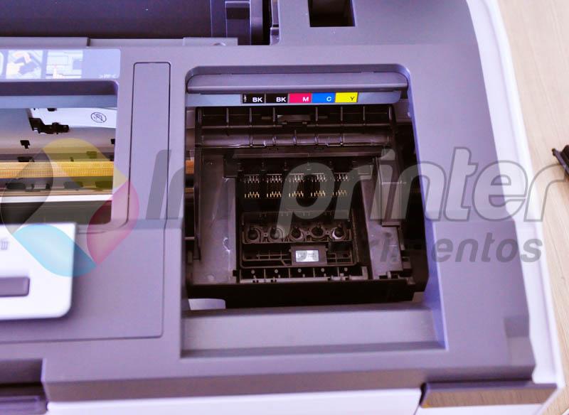 Removendo tampa do carrinho de cartucho da impressora Epson T1110